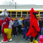 LINCOLN CARDINAL FOOTBALL PLAYERS were sent off to their State Championship Game in style with a parade on Friday. KC Wolf and the Cardinals' own mascot greeted players and fans during the well attended event.