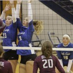 CASSIDY CARL #33 AND MADISON TREECE # 8, goes up high  for the Cole Camp Lady Bluebirds. Cole Camp won 25-17 and 25-11 last Tuesday.