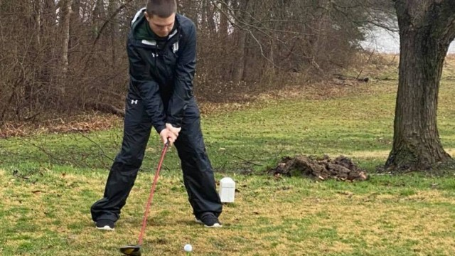 AMID BLUSTERY COLD weather conditions, Wildcat golfers played in their first matches last week in over a year after having their 2020 season canceled.  Warsaw's Coehen Walton (above) teamed up with Carson Bonner at the Higginsville Frostbite Scramble last Tuesday.