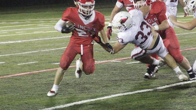 LINCOLN'S JOHN FAULCONER avoids a would be tackler during Lincoln's 43-15 loss at home to Tipton on Friday night.