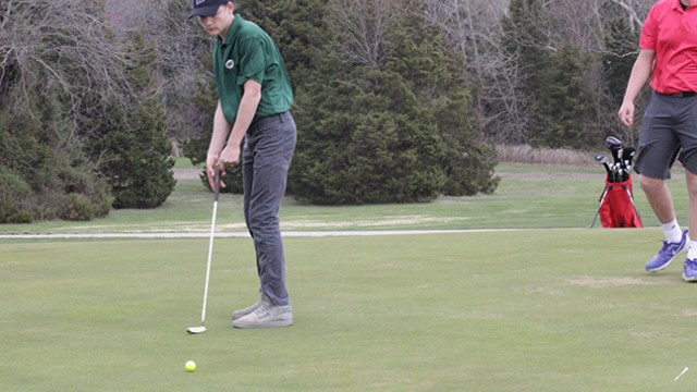 WARSAW SOPHOMORE JESSE BARCKLEY WATCHES his ball roll toward the hole in golf action on Friday night at Shawnee Bend Golf Course near Warsaw. This is Barckley's first year of playing golf.