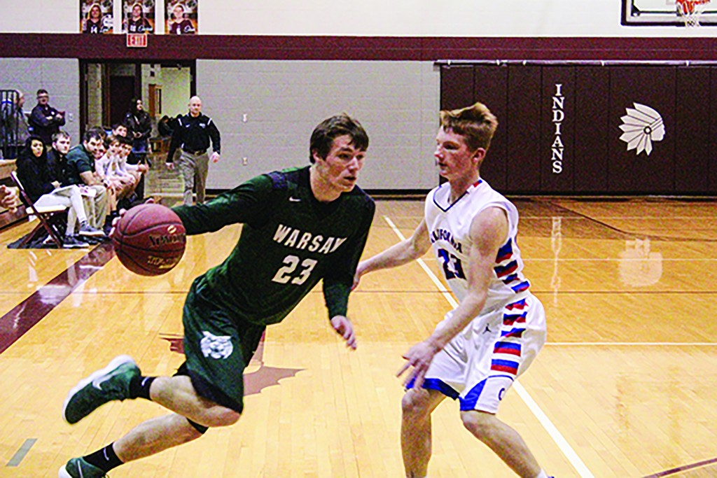 HIGH SCHOOL BASKETBALL can be very unpredictable . Sometimes even harder than filling out a successful NCAA bracket. Warsaw surprised everyone ,even their Coach Scott Floyd by winning 13 games this past season. Matt Luebbert drives around a California defender in the picture. Luebbert was named to the Media All- Area poll this week.