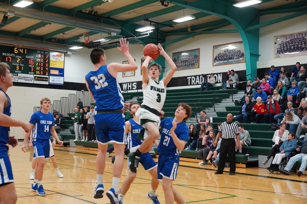 GOING IN FOR THE CONTESTED SHOT was Warsaw's Trey Palmer in last Thursday night's all-Benton County battle featuring the Wildcats and the Bluebirds.  Cole Camp would win the game, 70-54.  Palmer finished with a game high 24 points. Photo courtesy of Heather Montez.