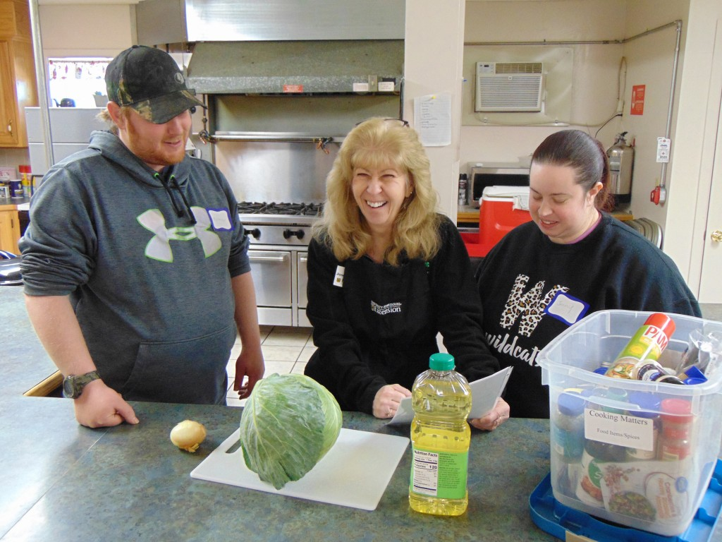 THE JOY OF COOKING is on display each Friday where classes for it are being taught at the Methodist Church in Warsaw.  Participants who include Matthew Smith and Jenny Brown are under the direction of Susan Jones-Hard.
