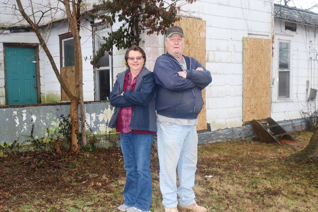 ON THE FRONT LINE in the fight against blight, City of Warsaw employees Jill Cobb  and Doug Hedrick work to enforce the Nuisance Ordinance to promote public health, safety and welfare. The City has worked with property owners to clean up yards and board up dangerous dwellings. One example was this Main Street home that had long been out of compliance. The current owner has done major clean up of the yard and boarded up the windows.