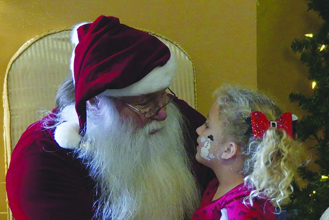 """CHRISTMAS CHEER filled Warsaw on Saturday with jam packed events that included breakfast with Santa at the Community Building. Gracie Tharaldson gave the """"Big Guy"""" her list."""