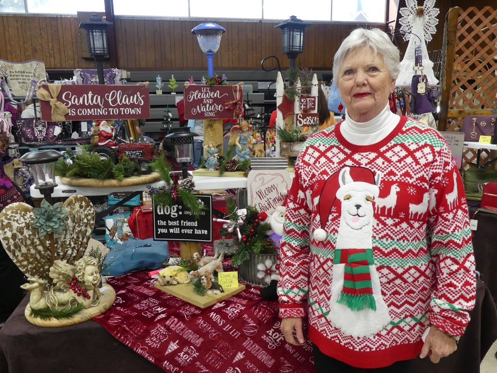 COLE CAMP WAS FILLED WITH CHRISTMAS CHEER on Saturday during the annual Christbaumfest Craft Show. One of the many attendees was Marge Lumpe.  The twin-lakes area will host a variety of concerts, parades and lighted displays this season. See the story below for full details.