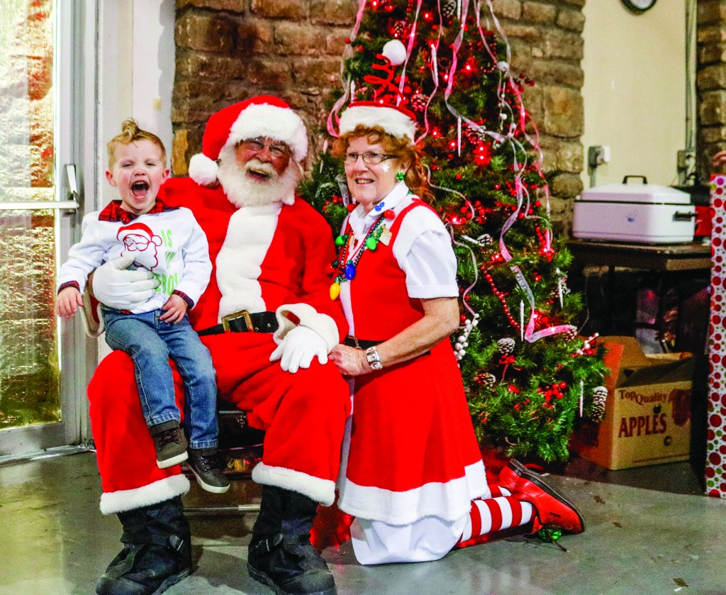 EXCITEMENT FILLED THE AIR as Bronx Boyer visited with Santa Claus and Rozella Holm at the Warsaw Community Building on Saturday.