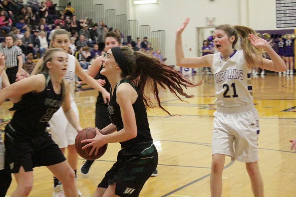 HANNAH CHAPMAN LOOKS TO SHOOT against Hallsville last Friday night on the road. Chapman had 19 points as Warsaw lost a tough one 44-42