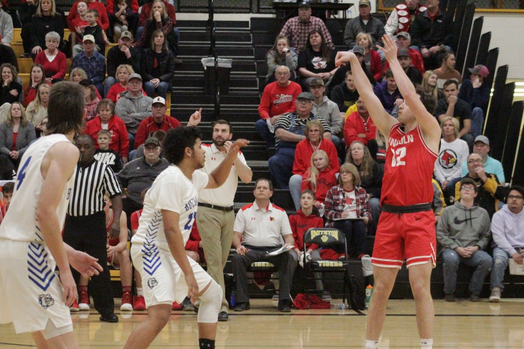 LINCOLN'S NATE HESSE RIPS A BIG THREE against New Franklin in the second round of district play at Smithton on Thursday night. Lincoln lost to the number one seed 62-55.