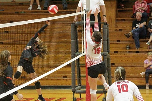 LINCOLN'S CALLIE SPUNAUGLE GOES UP high to block a smash by a Northwest player on Tuesday night. Lincoln won in five sets
