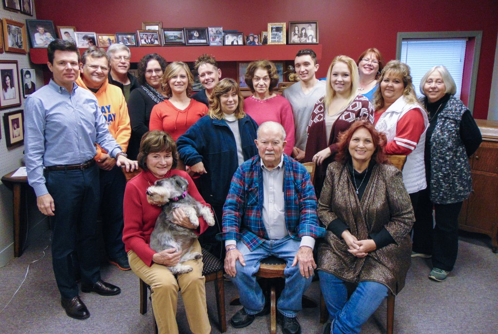 HAPPY NEW YEAR FROM THE STAFF OF THE BENTON COUNTY ENTERPRISE. We are, front row left to right: Jo White and Molly, Homer May, and Anita Arnett Campbell. Back row left to right: James Mahlon White, Johnie J. Logue, Barry Edwards, Rachel Sherrer, Rachel Grinstead, Tabitha Mounkes, Lisa Firsick, Joyce Coates, Tyler Simons, Taylor Bunch, Carrie Rieman, Kim Keeton and Lonnie Taylor. Unable to be present for the picture were Jane Salley, Paula Spring and Judy Kramer.