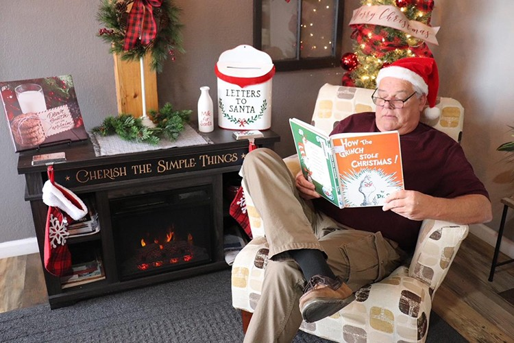 VIRTUAL EVENTS mixed with socially distanced programs are scheduled across Benton County to celebrate the Christmas Season. Chuck Allcorn is one of several well known citizens who will read holiday books to kids online. The program is designed to help replace the cancellation of Christmas on the Harbor events that normally take place in December.