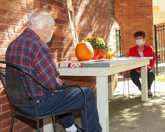 """FAMILIES have been able to reunite with loved ones at Warsaw Health & Rehabilitation Center with newly approved outdoor visits. Kay Hopkins spent time visiting with her Dad Melvin Hopkins and told the Enterprise, """"The wait was long, but well worth it!"""""""