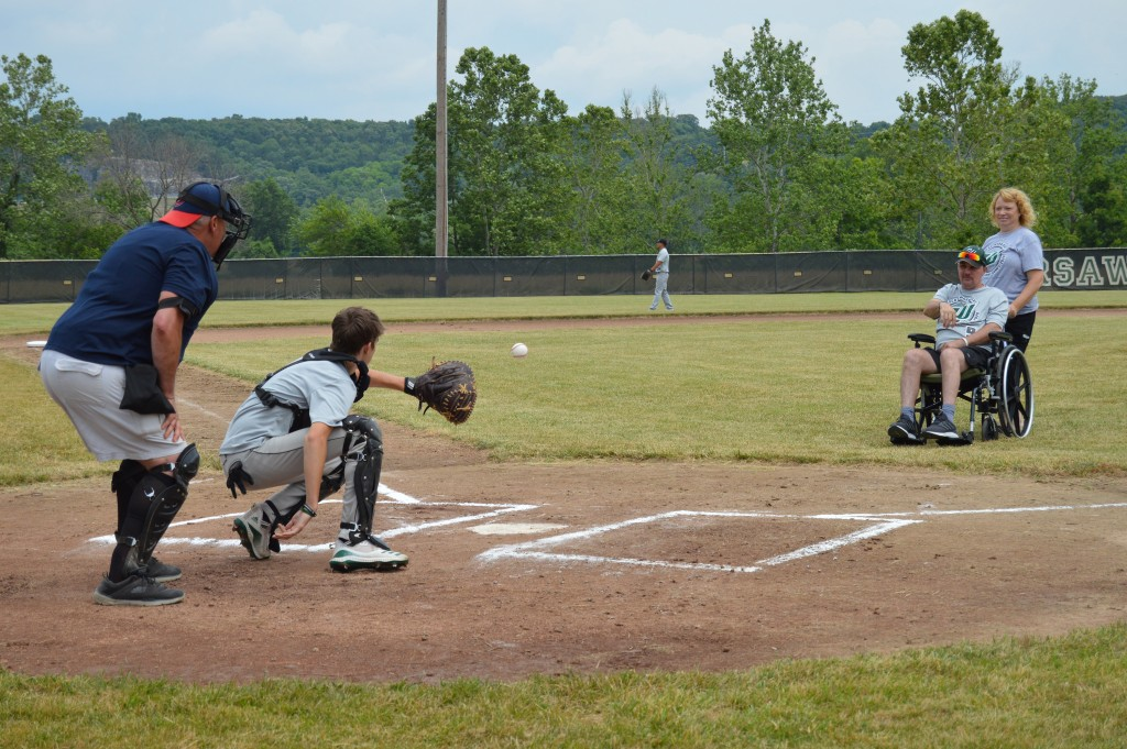 A PERFECT STRIKE was delivered by Will Palmer as he threw out the first pitch of the WHS Alumni baseball game this past Saturday at West Bledsoe Ferry Sports Complex.  The event, which also included a softball game, was held in honor of the Palmer family to help with needs resulting from Will's recent diagnosis of Glioblastoma. Will's son, Trey, received his throw while his wife, Cathy, coached him.