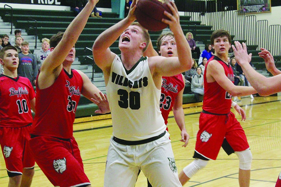SOPHOMORE LANE BATES goes up for a shot against Buffalo last Tuesday at WHS. Warsaw beat Buffalo 71-62 to move to 6-3 on the season.