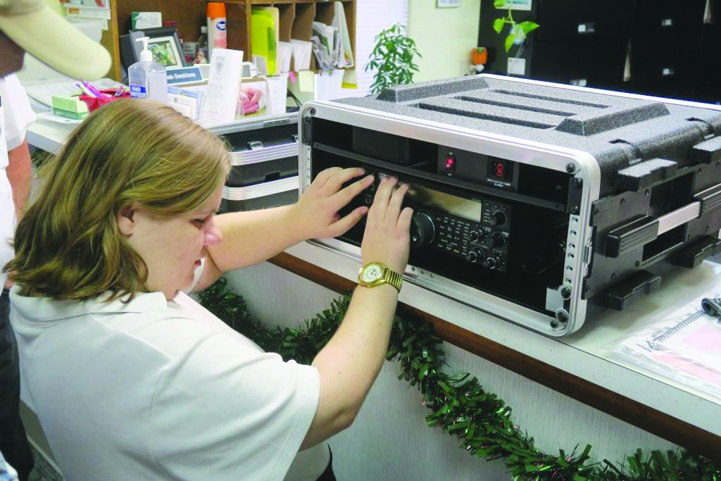 TAKING TO THE AIRWAVES on her specially equipped ham radio, Lincoln resident Kelly Stanfield enjoys talking to folks from across the country and the planet.