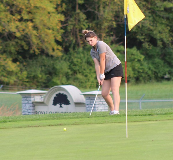 BROOKE ANDERSON FROM COLE CAMP chips the ball onto the green. She led Cole Camp with a 51.
