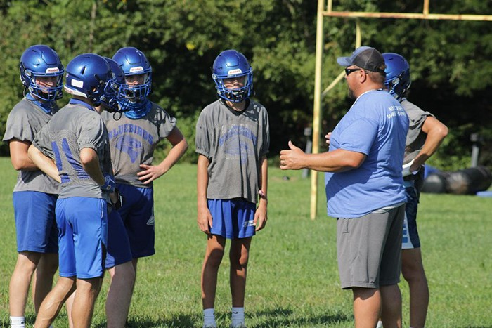 COLE CAMP Assistant Coach Nate Steenburgen talks to his players during opening day of practice on Monday. Some 25 players showed up. Cole Camp will host Warsaw on August 28.