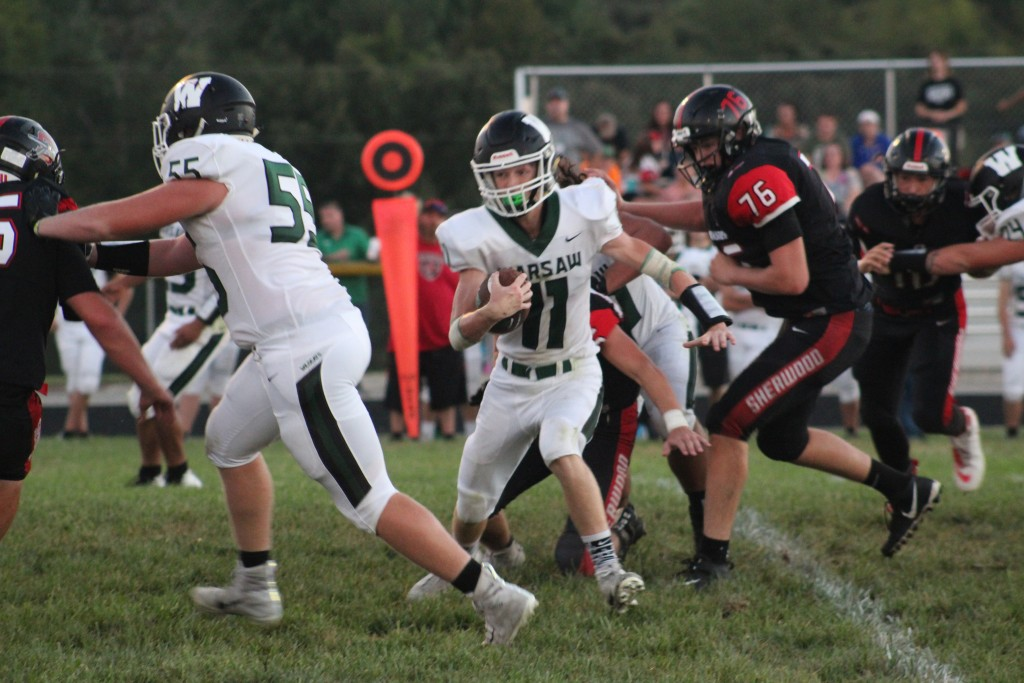 WARSAW'S ZACH CHAPMAN (#11) TAKES off around Lane Bates (#55), in the game of his career in Sherwood on Friday night. Warsaw would win their first game of the season 48-6 to go to 1-3 and will travel to Buffalo this Friday night. You can watch it on BCE TV with Barry Edwards. Pre-game starts at 6:30.