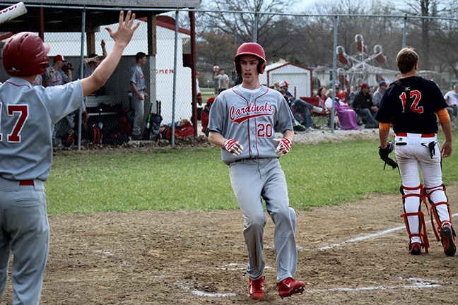LINCOLN'S (#20)CORBIN REESE scores standing up thanks to the sign by (#17)Levi Betts in Saturday's 14-2 win over Stover.