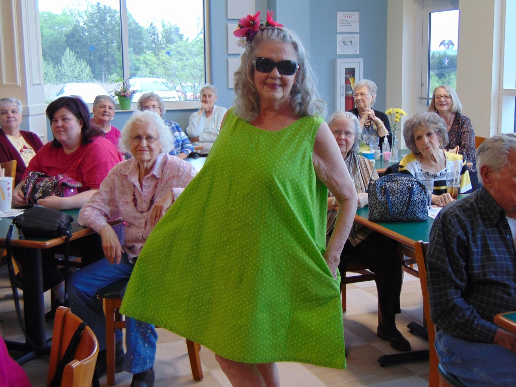 LETTING THE RUNWAY BE HER GUIDE, Jene Heape modeled a custom designed swim suit cover up during Thursday's Spring Fling Fashion Show at Harbor Village.