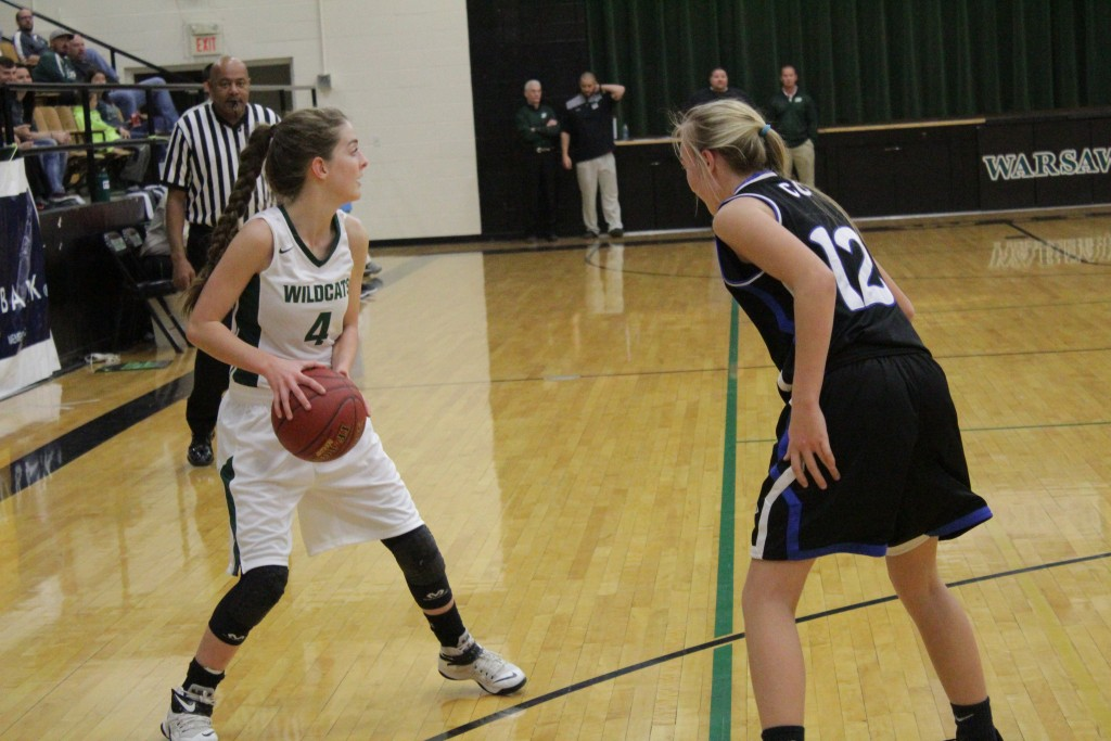 HANNAH CHAPMAN PREPARES TO PASS against Cole Camp last Friday night in the consolation game of the Warsaw Tournament. Chapman playing with an injury, scored 14 points  and combined with  Freshman Kylee Fajen's 14 points lead Warsaw to a 50-37 victory.