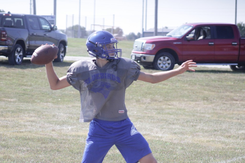 JUNIOR QUARTERBACK KADEN HARMS looks to improve on his all-conference award and his 16 touchdowns passes and his 90 completions of last season.