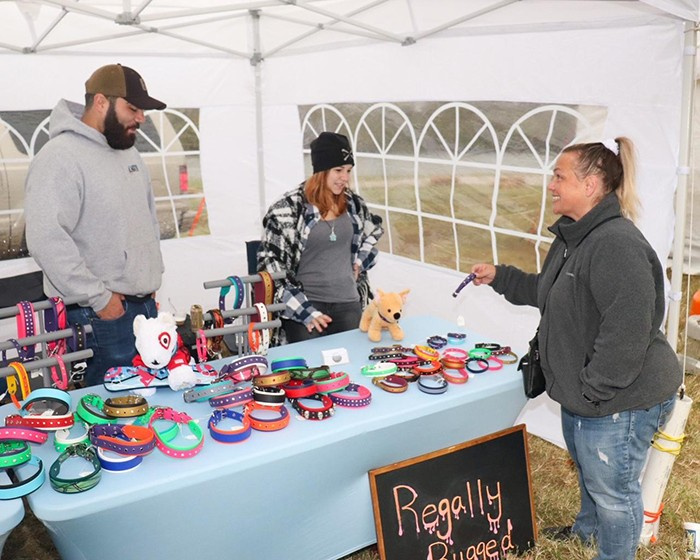 A SENSE OF COMMUNITY was front and center at this year's annual Heritage Days event held at Drake Harbor last weekend. Melissa McNeal attended this year's event and shopped at the Regally Rugged booth operated by Bradley Buth and Elizabeth Appel.