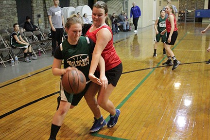 WARSAW'S LANEY ARNETT  drives around Clinton player during the  opening contest on Monday night. Warsaw lost 24-14. Skyline 1 beat Lincoln 25-4 in the first game of the night.