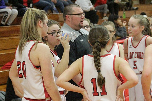 COACH KEVIN LAFAVOR TALKS to his junior high girls basketball team during a time-out on Thursday night in Lincoln. LaFavor has accepted the head coaching football job in Clinton for next season.