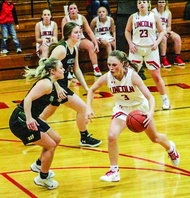 IT WAS A BATTLE OF THE GUARDS as Lincoln junior Jenna Vandaveer drives on Warsaw junior Taylor Howe in Monday's All-Benton County game at Lincoln. Warsaw won 53-49. Howe hit four big free throws in the final minute as she was 10-10 on the night from the charity stripe. She had 21 for the game and Vandaveer had a game-high 31.