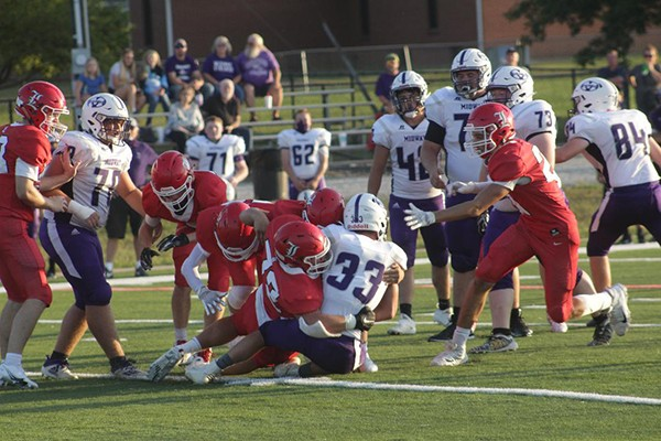 ALL STATE LINEMAN GABE MEHRENS tackles Midway's top running back Mayson Adams during Lincoln's 18-6 home win last Friday. The Cardinals will travel to Windsor this Friday night.
