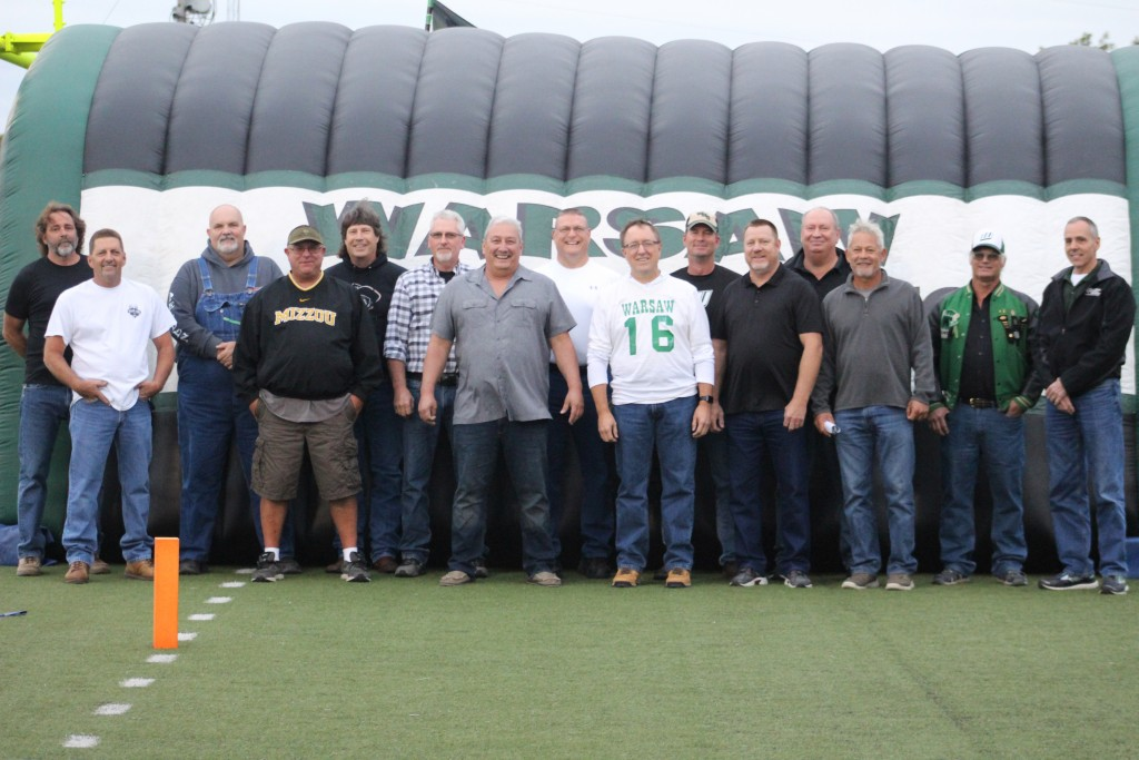 THEY WERE THE GLORY OF THEIR TIMES. The 1978 Warsaw football team returned last Friday to the field where it all began. Pictured left to right- Mark Porter, Ron Roelling, Ray Findley, Eddie Carroll, Mark Eason, Billy Shinn, Ernesto Flores, Leo Porter, Scott Rolf, Clay Kreisel, Paul Eason, Darrel Eason, Gary Martinez, Mike Munson, and Stephen Porter.