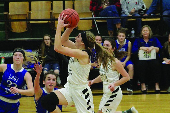 WARSAW JUNIOR AUBRIE MCROBERTS DRIVES to the basket against Climax Springs. McRoberts scored her 1,000th career point in a 47-46 loss to the Lady Cougars.