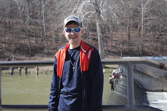 WARSAW'S JOHN TAYLOR STANDS OVER ONE OF THE SPILLWAYS at Bennett Springs State Park on opening day on Thursday, March 1, 2018. Notice the fishermen standing on the spillway ledge. The water was murky and very few fish over five pounds were weighed in at the Trading Post Store.