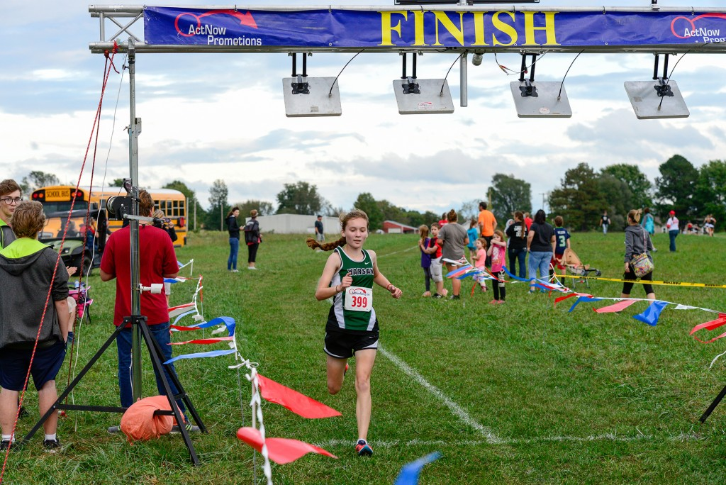THERE WAS  NO ONE IS SIGHT AS WARSAW FRESHMAN ALYSSA  ALCANTARA crossed the finish line last Tuesday evening in Buffalo, MO. Alcantara won the first ever Ozark Mountain  Conference Cross Country Championship.
