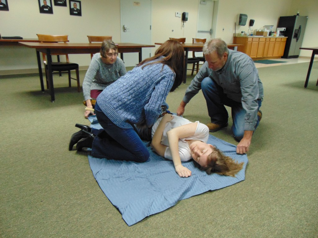 ACTIVELY TRAINING  as part of the Community Emergency Response Team, Christy Barber, Marie  Payne-Bowman, Stanley Williams and Samantha Henley practiced moving an injured person. Bowman and Henley helped instruct the class held on Tuesday in Warsaw