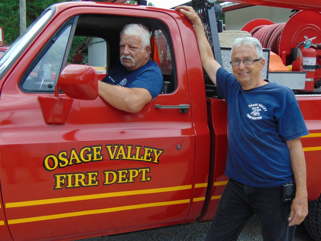 FIGHTING FOR FREE, Fire Chief Ron Taddiken and Fireman Mike Burge volunteer for the Osage Valley Fire Protection District.  As with many rural fire departments, the organization is in desperate need of additional volunteers.