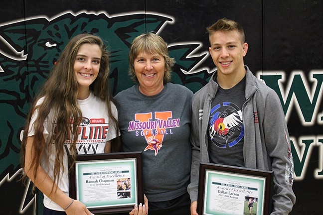 THE BEST OF THE BEST. The 2017-18 Jackie Downing and the Jerry Lumpe Award of Excellence awards winners Hannah Chapman and Dallas Larsen pose with Jackie Downing at WHS on Monday. The awards are presented to the female and male senior athletes who excel in athletics, academics and attitude. Congratulations!