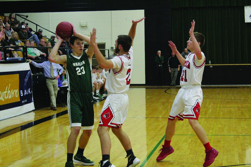 WARSAW'S MATT LUEBBERT IS GUARDED IN THE CORNER by Lincoln's Grant Eifert and Jackson Beaman in the semi-final matchup on Thursday night in the 85th Warsaw Tournament. Luebbert had 36 points in a losing effort while Jackson hit the last shot to give Lincoln a 61-60 victory in a game that will not soon be forgotten.