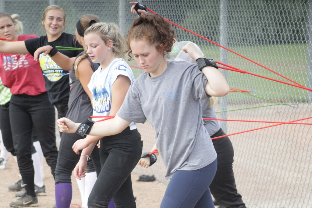 JUNIOR PAYGE ADAIR STRETCHES DURING the first day of practice for all Warsaw sports on Monday morning at West Bledsoe Ferry Sports Complex. Adair and the other softball girls are looking forward to a great season as they are loaded with talent.