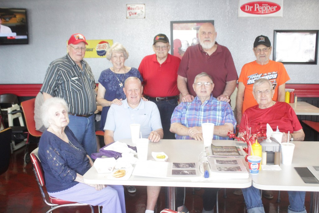 """Local Race Car Enthusiasts and Hall of Fame racers of the fifties and sixties had a reunion at Estes Drive Inn in Lincoln last week. Those in attendance sitting down were (L-R) Betty Chapman, Dale Morre, Ray Lee Goodwin and Virgil Chapman. Standing are Ed Sanders, Judy Moore, Charlie Bybee , Raymond  """"Heavy"""" McNish and Terry Richards. Not pictured is Teresa Osmond."""