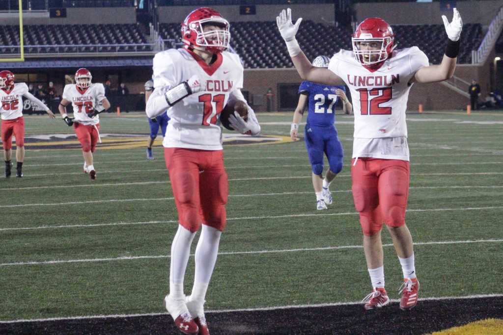 THE LINCOLN CARDINALS REJOICE after scoring a late fourth quarter touchdown again Valle Catholic. Regional Radio recently rated the Class 1 State Championship game as their top broadcast of 2019-20.