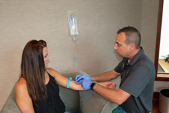 A NEW TREND is sweeping the nation with medical firms making house calls to offer hydration IV's to customers. Optimize Hydration recently opened its doors in the Truman Lake Area. CEO Rob Coskey administered a B-12 injection to Deanne Glenn during her lunch hour.