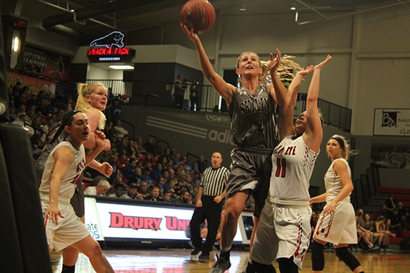 Kaylee Damitz, Of The Defending State Champions, the 28-2 Skyline Lady Tigers drives for a basket against Blue Eye on Saturday at Drury College on Saturday. Skyline won and are going back to final four this Thursday for their six straight trip and 14th over all.