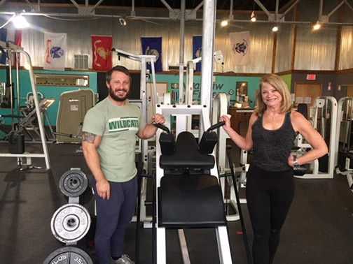 AN INNOVATIVE PROGRAM to help seniors stay fit, Brian Phillips helps train 69 year old Kay Wingfield at Warsaw Fitness through Medicare Advantage's Silver Sneakers.