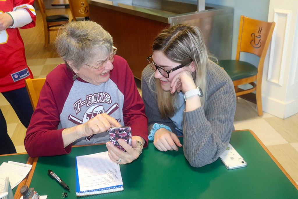 CONFUSED BY TECH? There's a teen for that as part of a program under the direction of WHS Instructor Jowell Roellig.  Dolores Winsor worked with Lauren Kreisel at Harbor Village on Monday.