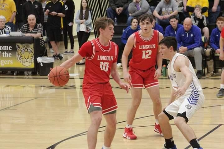 LINCOLN'S FRESHMAN KYLE ECKHOFF (10#) looks for an open man in a basketball game last season. Just 14 when his father passed away last year, Kyle has been an inspiritation to others with his hard work on the family farm, his dedication, and his work ethic.