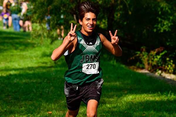 CRUISING ACROSS THE FINISH LINE, Warsaw's Bradley Watson claimed the gold in the middle school boy's division at Saturday's cross country run held at Sedalia's Clover Dell Park.  Photo courtesy of Ray Alcantara.